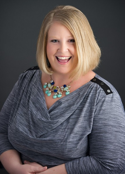 2 chics and a photobooth owner Maggie Hase poses for FUN professional headshot with photographer and posing expert, Kim Smith, of EichPhoto. Eichelberger Photography St. Louis, MO