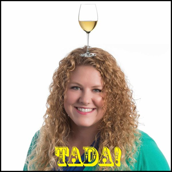 crappy headshot crop: girl balances wine glass on top of her head for no apparent reason